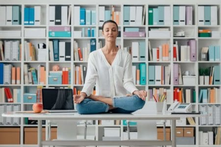 woman-practicing-meditation-on-a-desk
