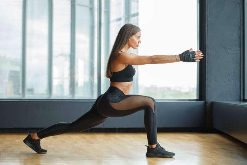 young-hispanic-athletic-sportswoman-indoors-gym