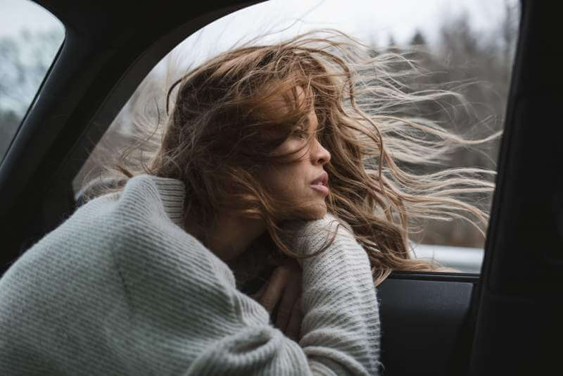 amazing-cute-girl-looking-out-from-car-window