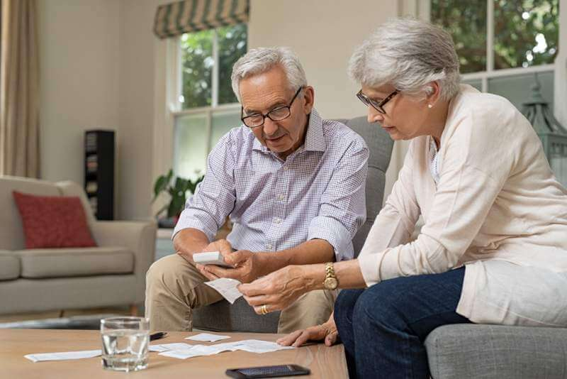 senior-couple-calculating-expenses