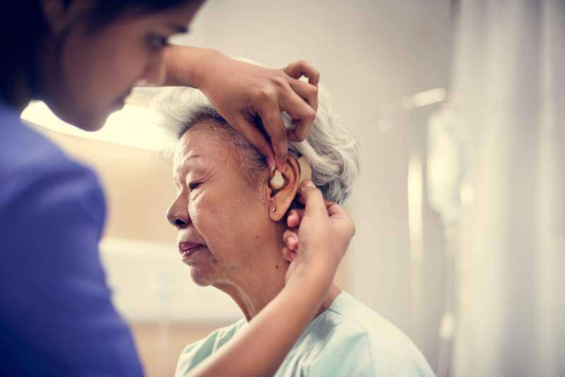 an-elderly-woman-with-hearing-aid