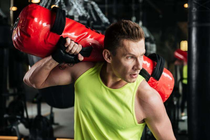 sportsman-holding-punching-bag-on-his-shoulder