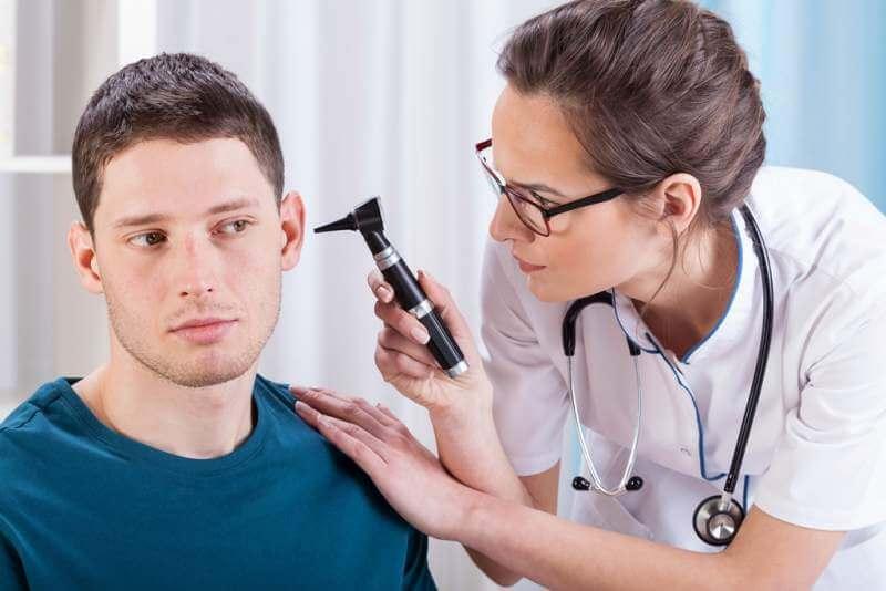 young-laryngologist-examining