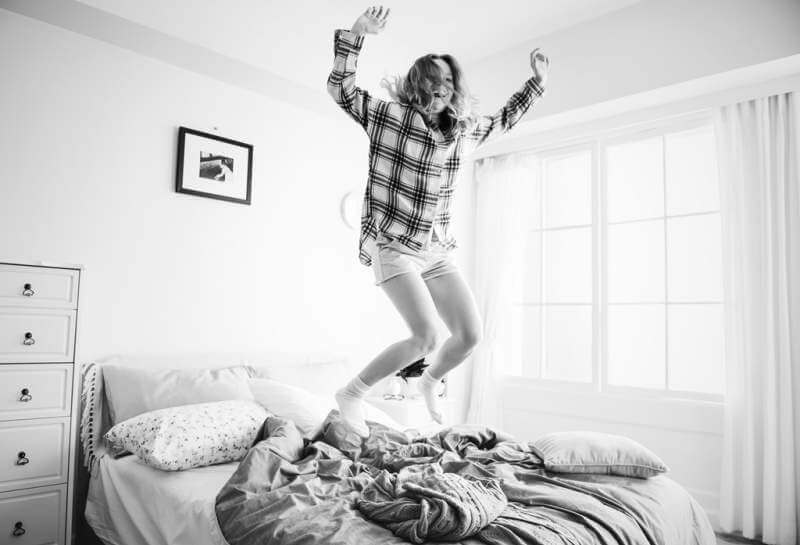 Young happy women jumping
