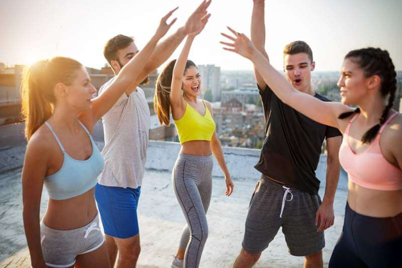 group-of-young-happy-people-friends-exercising