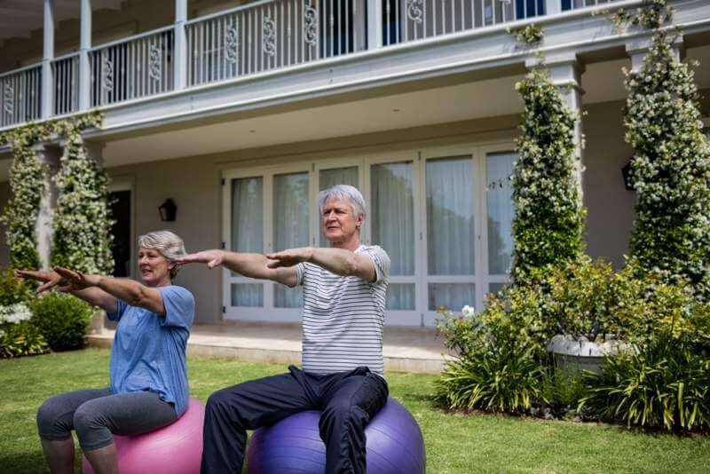 senior-couple-exercising-on-fitness-ball