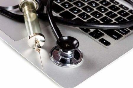 stethoscope-and-syringe-on-keyboard