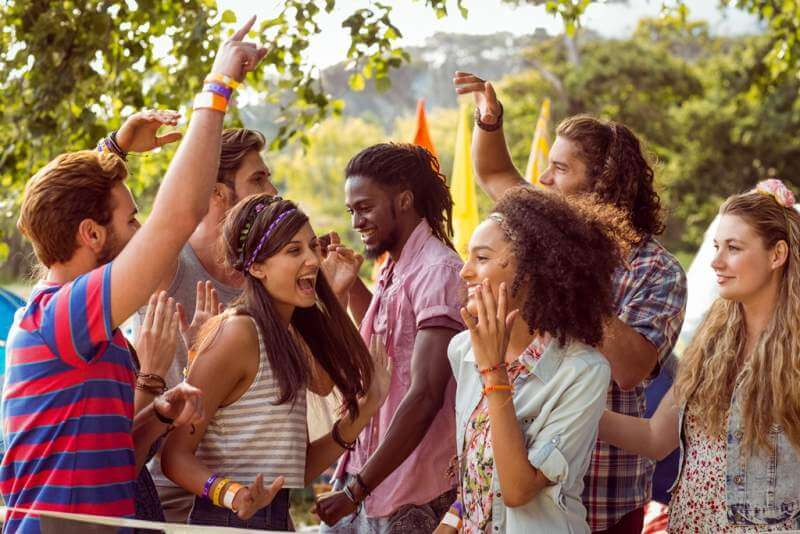 happy-hipsters-dancing-to-the-music-at-a-music