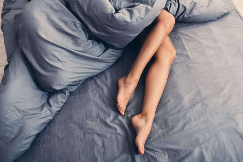 part-of-female-body-on-the-bed