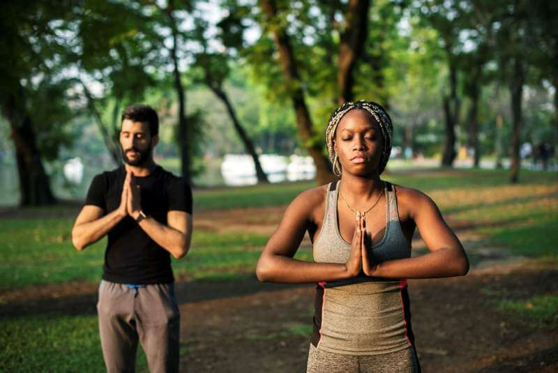 people-yoga-in-a-park