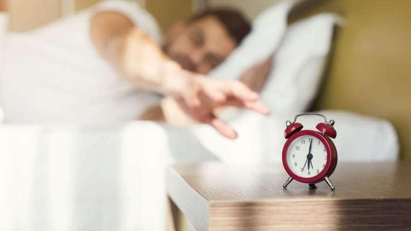 sleepy-guy-waking-up-early-after-alarm-clock