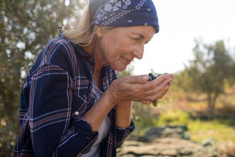 woman-smelling-fresh-olives
