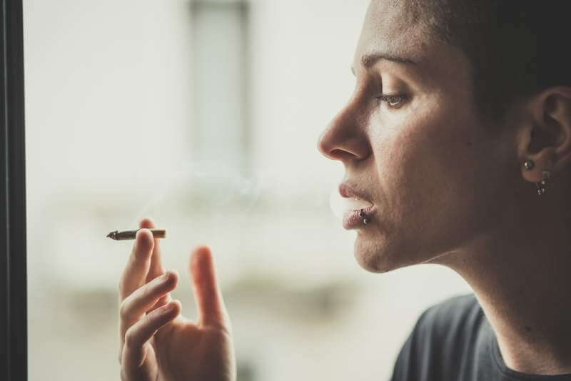 young-lesbian-stylish-hair-style-woman-smoking