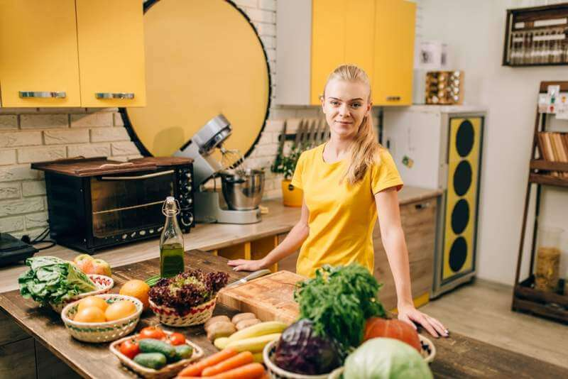 young-woman-cooking-on-the-kitchen-healthy-food