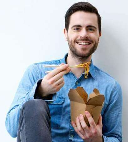 hungry-young-man-smiling-with-chopsticks