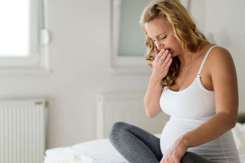 portrait-of-blonde-pregnant-woman-feeling-sick