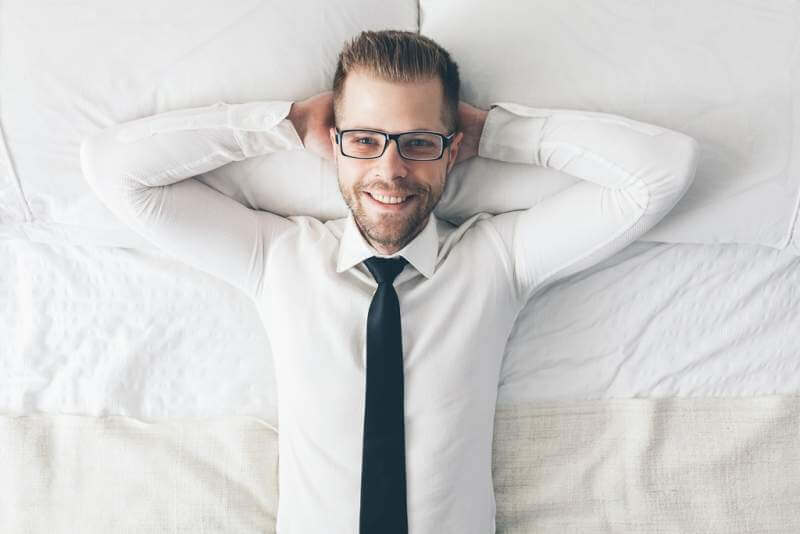 top-view-handsome-businessman-with-glasses-lying
