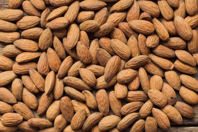 almonds-on-wooden-background