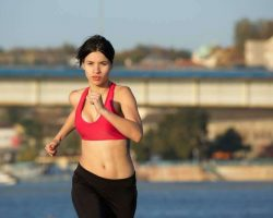 healthy-young-sports-woman-running-outdoors