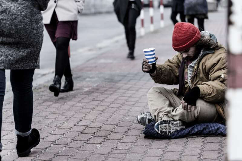 hopeless-beggar-on-the-sidewalk