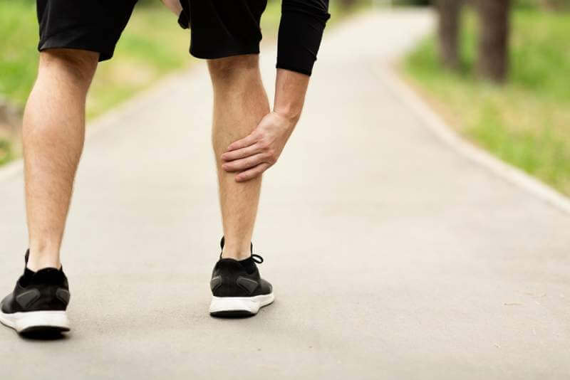 male-runner-is-suffering-from-calf-pain