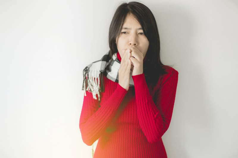 asian-woman-coughing-with-sore-throat