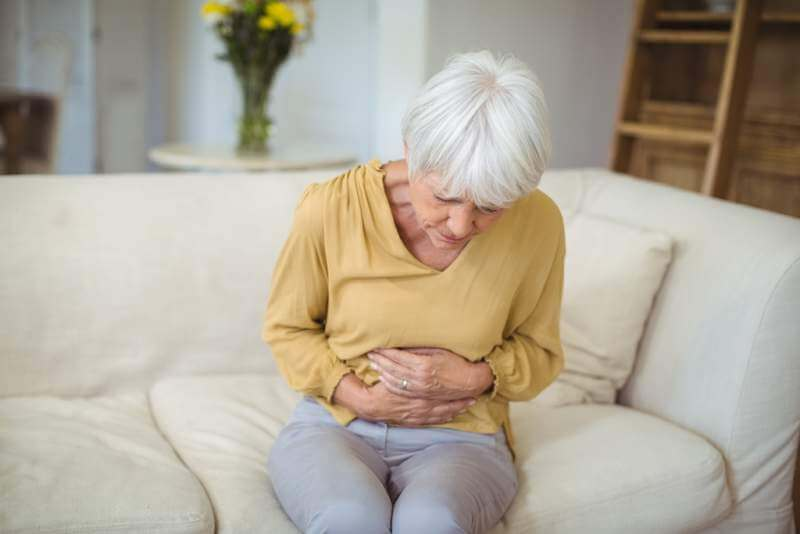 senior-woman-suffering-from-stomach-pain