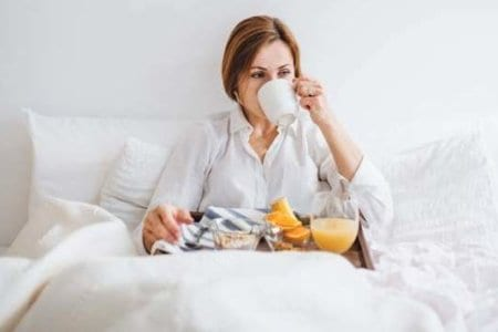 a-front-view-of-woman-having-breakfast-in-bed